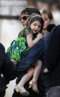 Suri Cruise hugging tom
