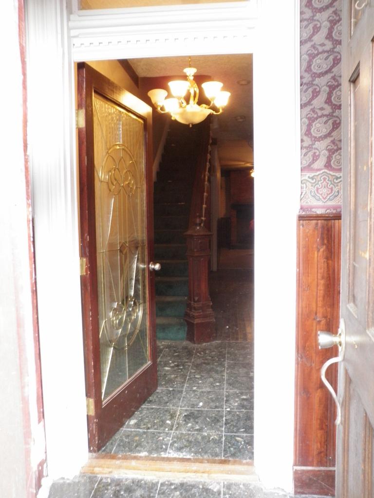 Front Doors (french doors into tiny vestibule, then second door into foyer)