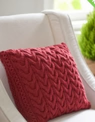 http://www.yarnspirations.com/pattern/knitting/christmas-cables-pillow