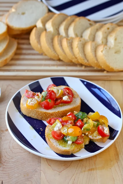 tomato-feta-appetizer on blue and white plate