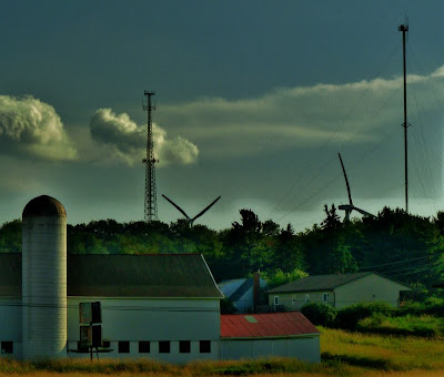 A Self Supporting Tower,A Guyed Tower and some Wind Turbines