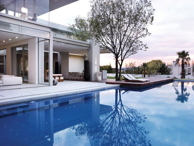 Large swimming pool in front of Modern Luxury House In Johannesburg