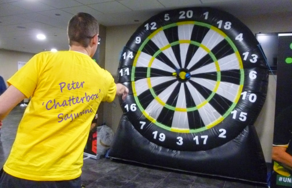 'Squire' Richard Gottfried playing a game if Inflatable Darts at the Unibet Masters - to win a Unibet 180 t-shirt you had to score 60 or more with three 'darts' (velcro balls)