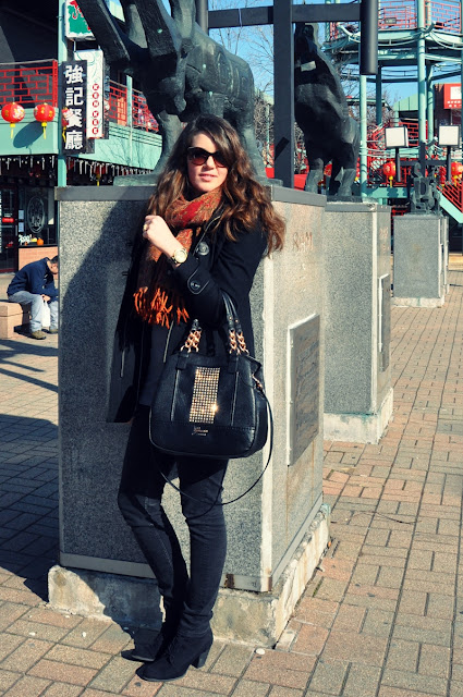 black outfit, guess studded bag, red scarf