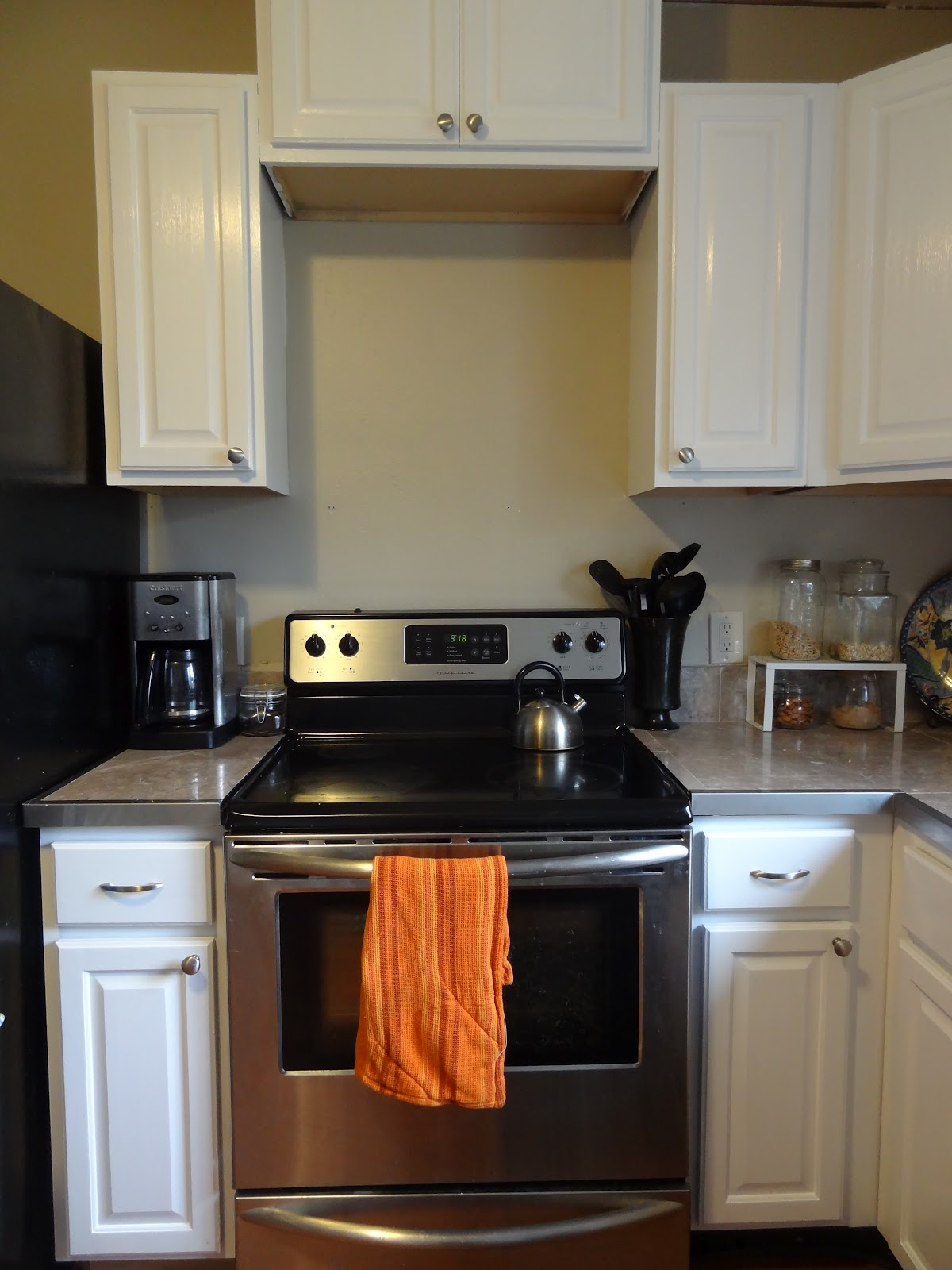 Diy how to paint kitchen cabinets white update revamp for Update white kitchen cabinets