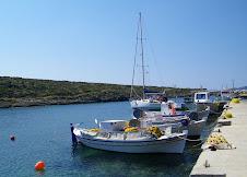 Algieba parmi les barques de pêche