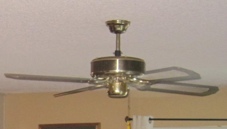 before dated brass ceiling fan with wicker cross hatch fan blades. Black Bedroom Furniture Sets. Home Design Ideas