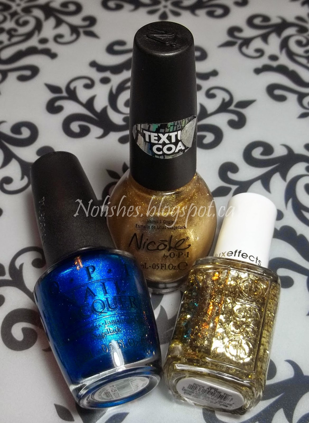 OPI 'Swimsuit... Nailed It!', Nicole by OPI 'Gold Texture', and Essie 'Rock at the Top'