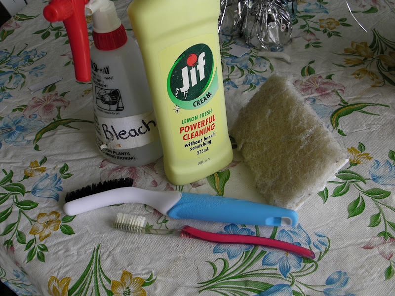 are the cleaning tools I used to scrub the grout in the bathroom title=