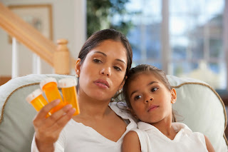 Photo of mother and daughter with prescription drugs.