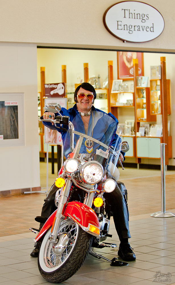 A local Elvis Tribute Artist, James Anderson (aka Gospel Elvis) on his red Harley Davidson inside the Orillia Square Mall.