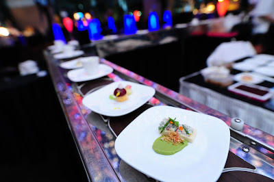 Source: LAVISH. The LAVISH Culinary Theatre featured small bites on a conveyor belt.