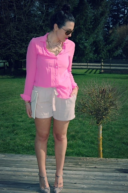 Pink silk Joe Fresh blouse, Lyocell Forever 21 shorts, Jessica Simpson suede T-strap heels and a Target clutch.