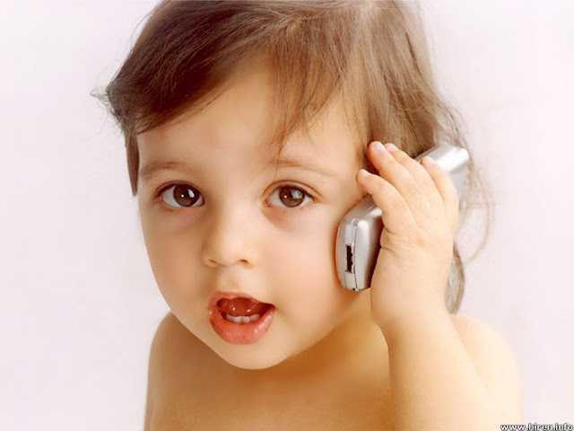 cute baby picture handing a cellphone calling papa
