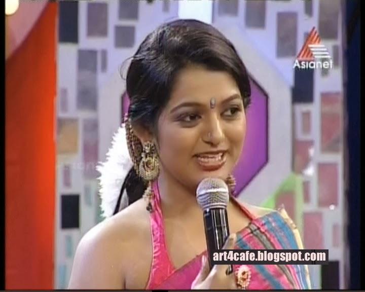 Television anchor Meera Anil latest hot photos in saree. Meera Anil