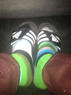Greyson's socks and sandals in a car