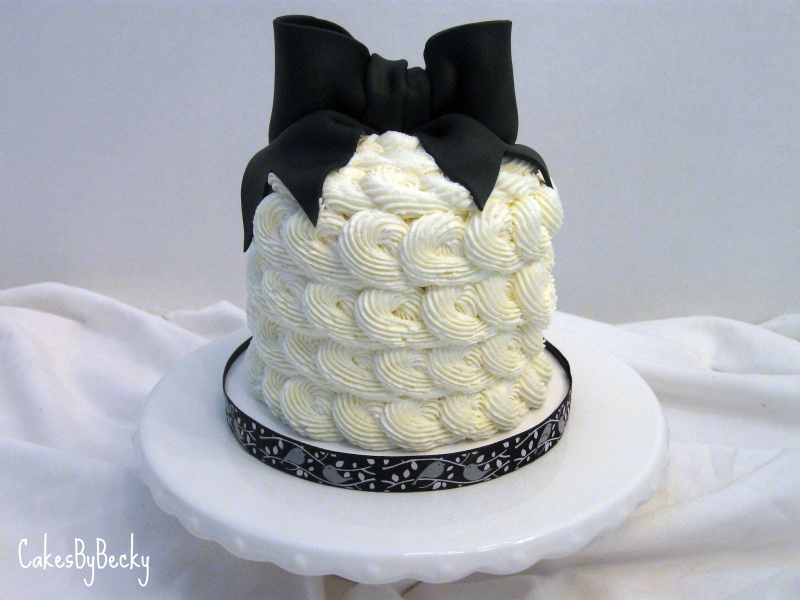 Cakes by Becky Ivory Buttercream Rosette Cake with Black Bow