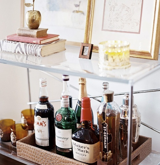 Creating a well stocked home bar just in case the mad men for Bar showcase for home