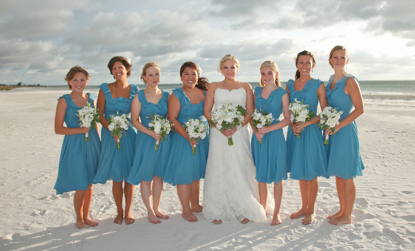 blue bridesmaids in flowy dresses
