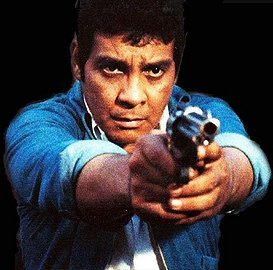 FPJ holding a gun pinoy movie blogger article on action films