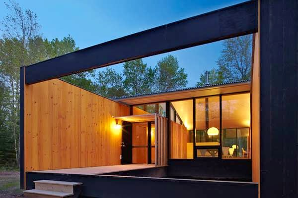 Minimalist prefab cottage modern design in small forest for Minimalist bungalow house design