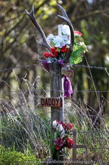 When a picture says it better than police or politicians, fatal accident roadside memorial, white cross photograph