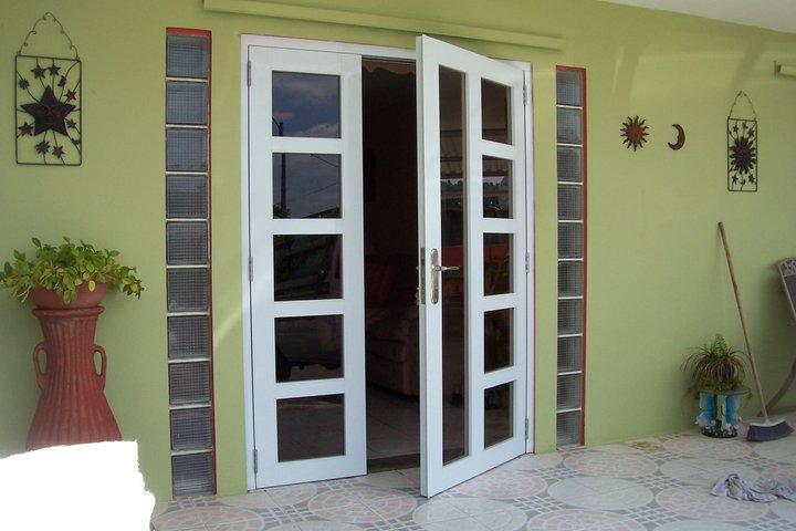 Dise o tropical inc puertas de seguridad en aluminio for Disenos en aluminio