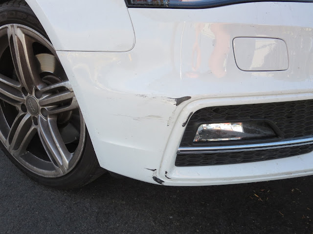 Scratches on bumper of Audi S4 before repairs at Almost Everything Auto Body
