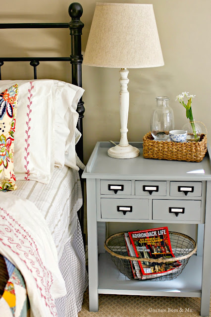 World Market preston table as side table in master bedroom via www.goldenboysandme.com