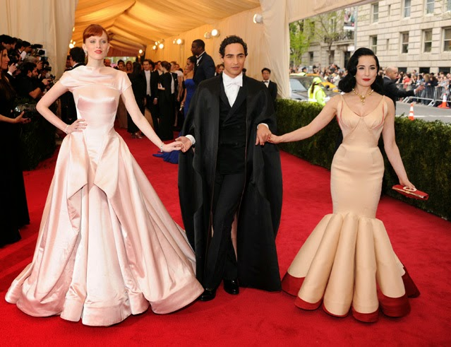 Karen Elson, designer Zac Posen and Dita Von Teese at the Met Gala 14.