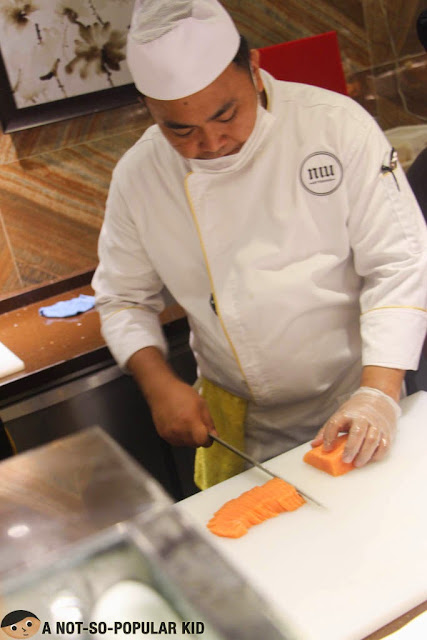 Chef Slicing Raw Salmon for Sashimi - Niu by Vikings