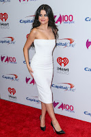 Selena Gomez strapless white crepe dress at Z100s Jingle Ball 2015 photos