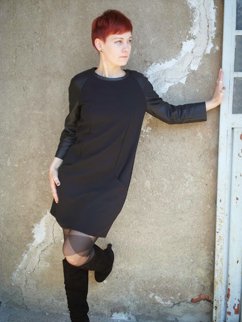 """Wearing a black shift dress, knee high boots, patterned tights. A look inspired by the cult tv series """"spaceship orion"""" 