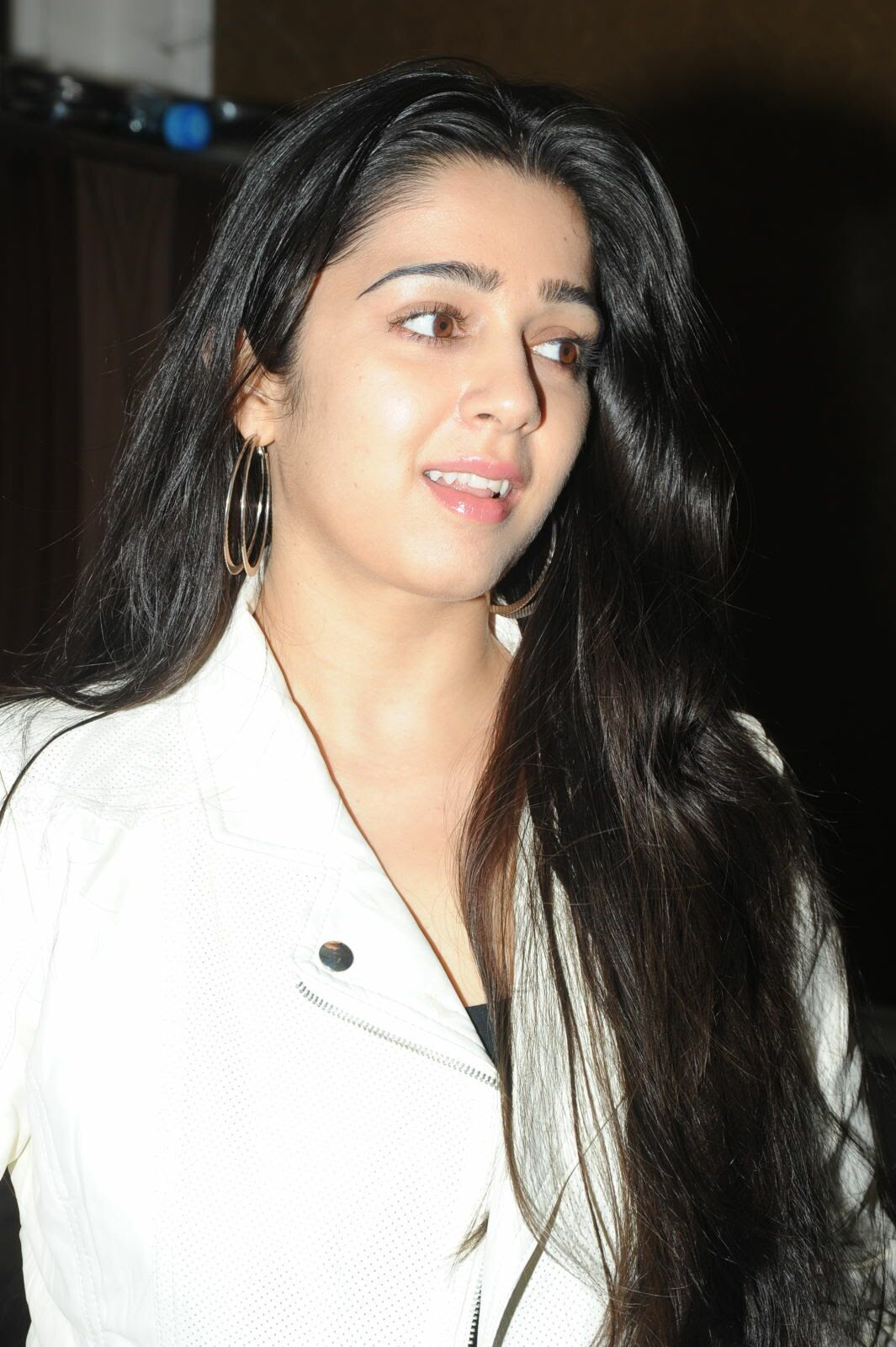 Actress Charmi Kaur Pictures in Jeans at One by Two Movie Celetes 20 Years Event  0047.jpg