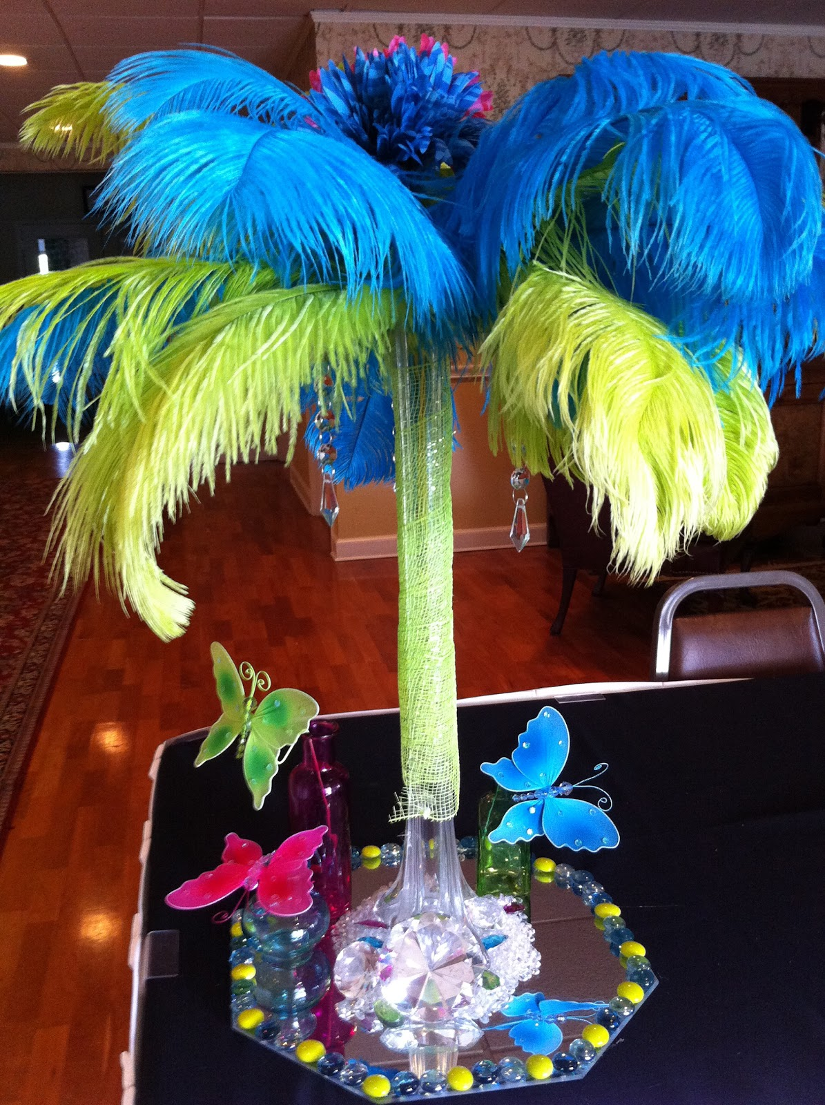 The posh pixie fanciful feathers centerpiece
