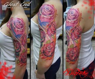tatuagens femininas na parte externa do braço desenho rosas