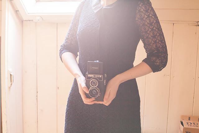 Girl holding a vintage lubitel 166B camera