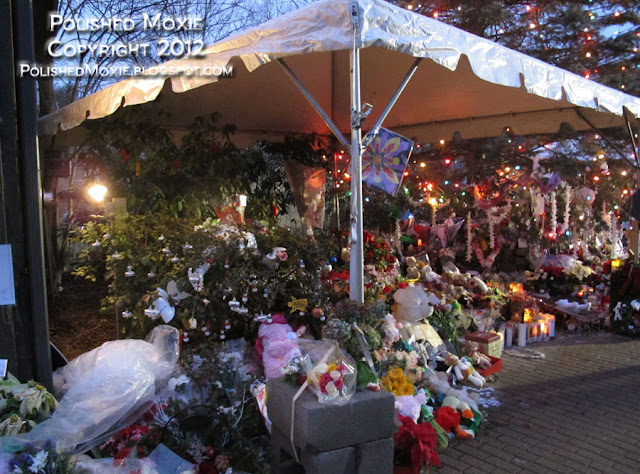 Image of large memorial filled with keepsakes at the center of Sandy Hook.