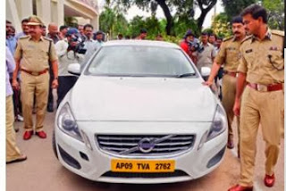 Policemen show the volvo car, which was used by accused to adduct the techie and rape her