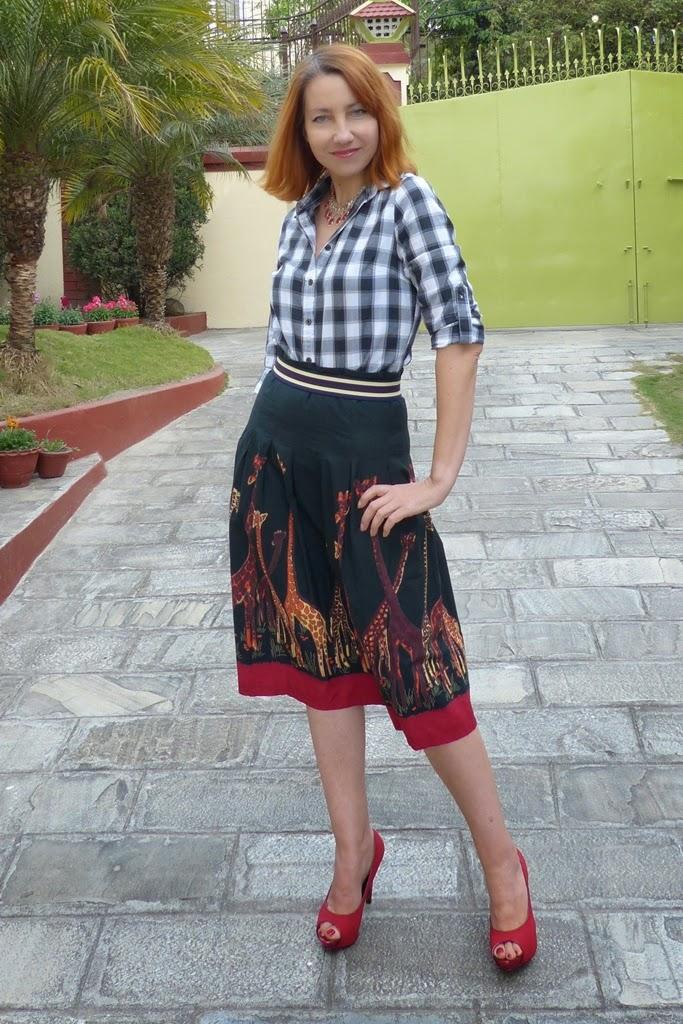 Checkered shirt, African theme skirt