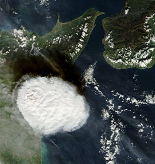Etna's eruption from Satellite, at right, Calabria, at left, Sicily.