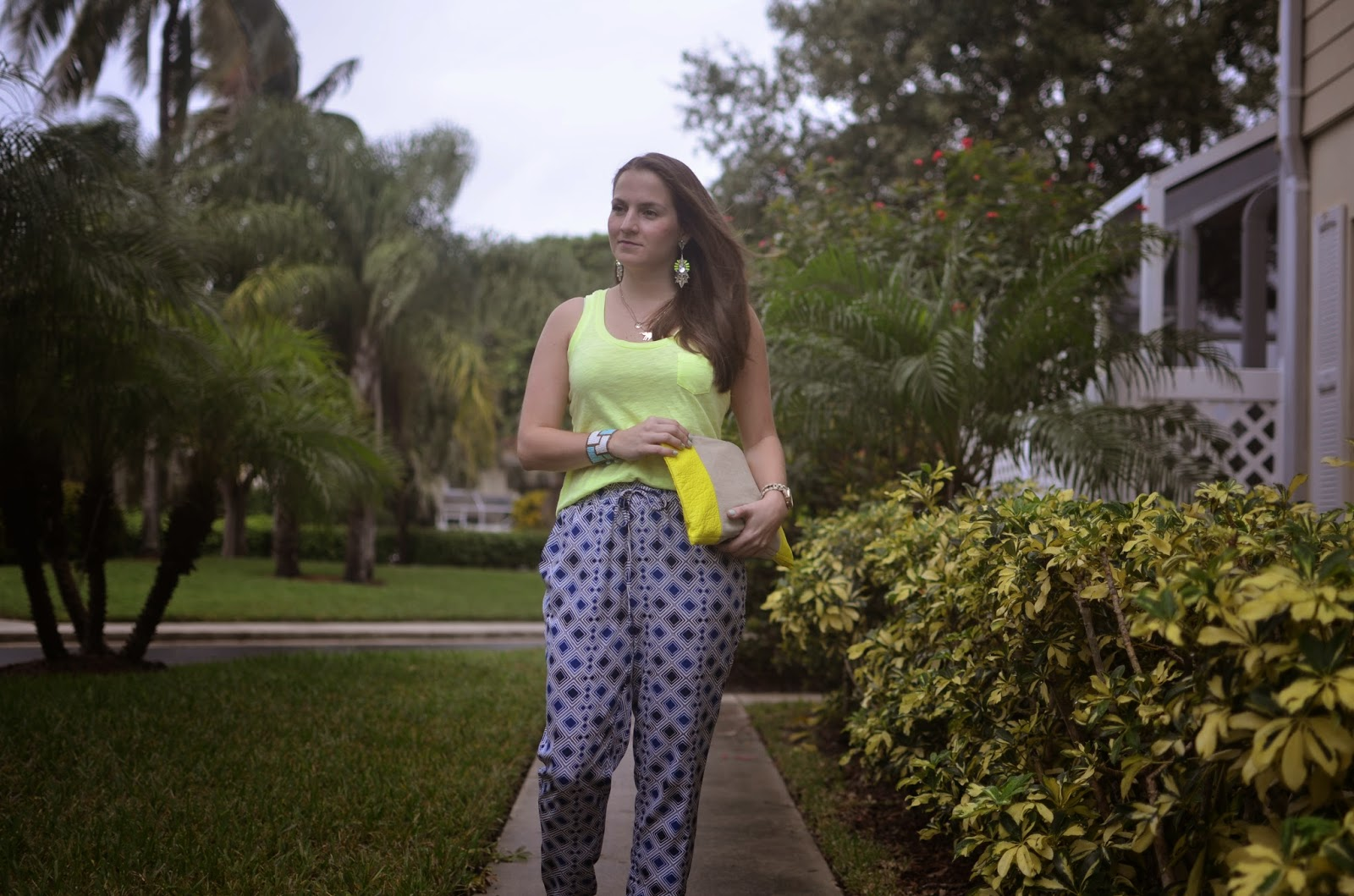 yellow tank - yellow clutch - printed pants - white sandals