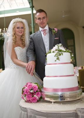 Cutting the wedding cake Wynyard Hall