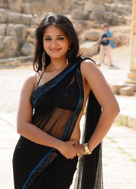 Anushka Shetty Spicy Stills In Black Saree 4