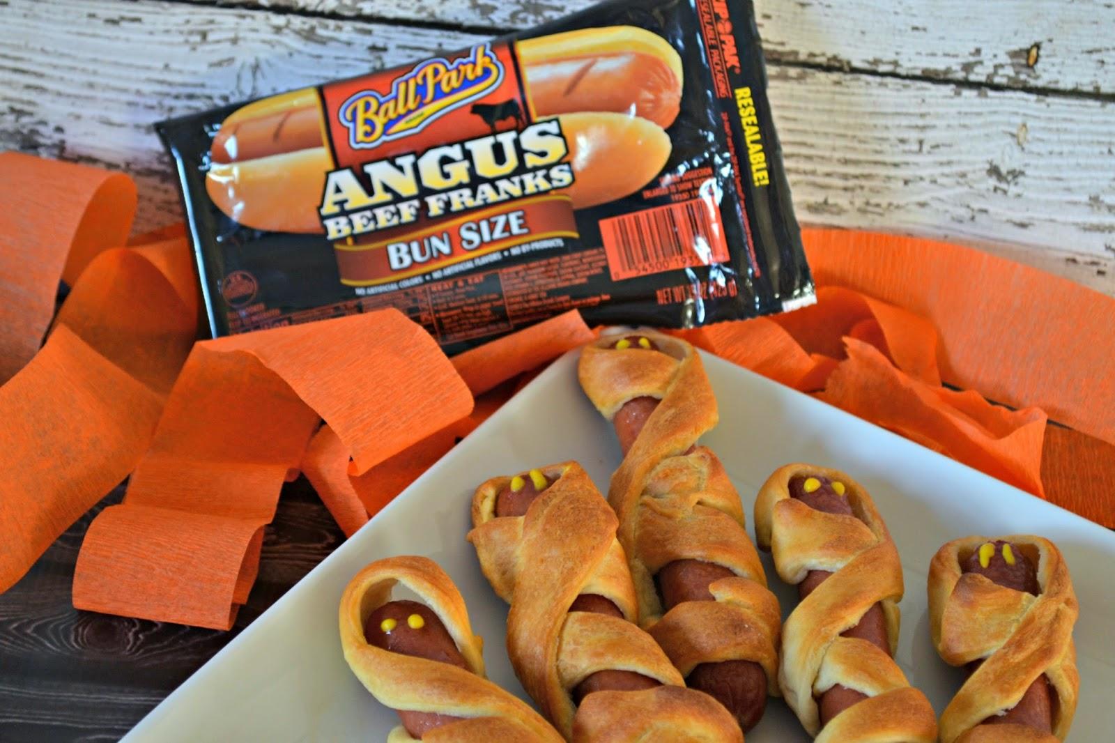 Mummy Dogs for Halloween Fun!  #recipe Halloween Dinner Ideas Creative Hot Dog meals Hot Dogs on Halloween Mummy Hot Dogs Recipe
