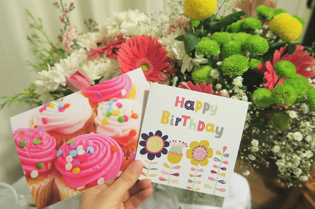 Birthday Cards in front of flowers
