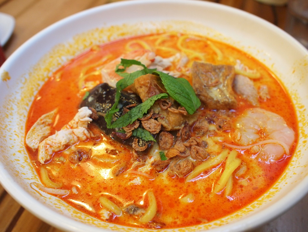 and a seafood laksa were ordered duck laksa combination laksa