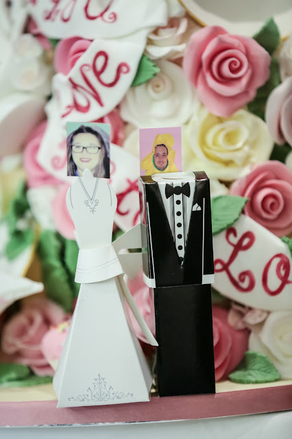 wedding place names with 3d bride and groom figures and a photo of each person as the head