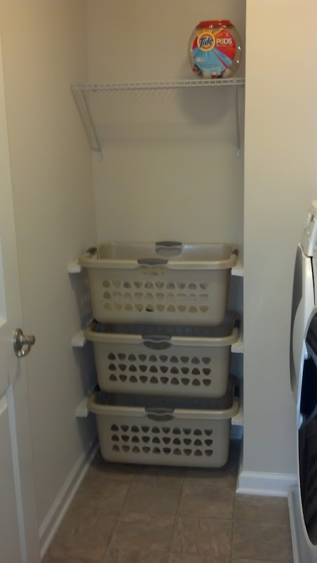 Small Side Baskets. That annoying empty space between the wall and the washer that just won't really hold anything can actually be very useful in organizing and storage. If your laundry room is only semi-hidden by a wall, you can use that tiny little space (or any tiny little space that you have available) to hold small plastic or metal baskets.
