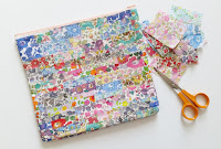 http://www.madforfabric.com/2015/10/03/diy-laminate-liberty-scrap-pouch/